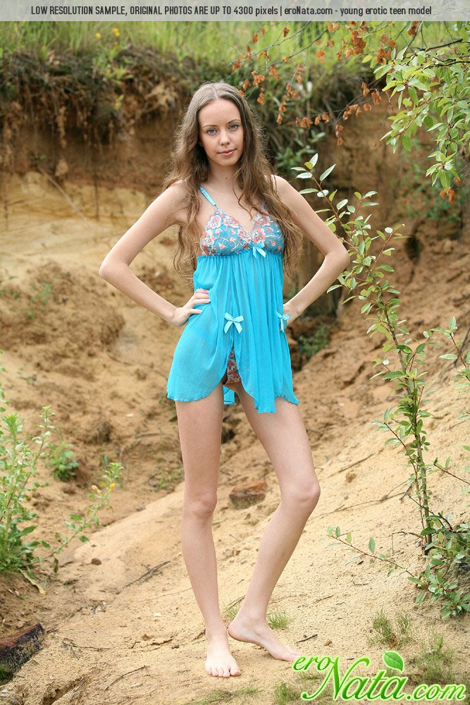 Nata shows off what's under her little blue dress