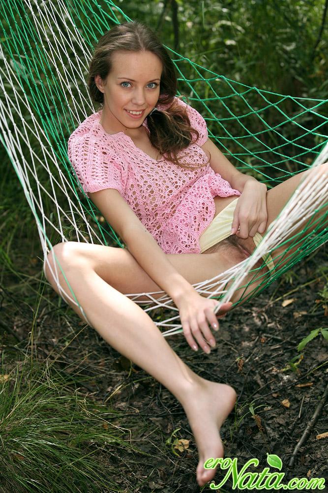 Smiling brunette Nata fooling around in the hammock